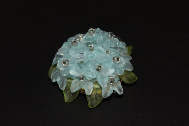 "A beautiful crystal blue bouquet of flowers with small rhinestones in the middle of each, this brooch is so unique and stunning. The stamp on the back says ""West Germany"""