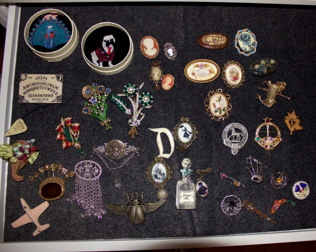 I opted for this small pull-out drawer for my overflow brooches and sunglasses.